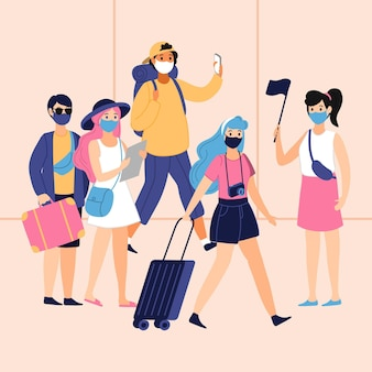 Turisti che indossano maschere per il viso