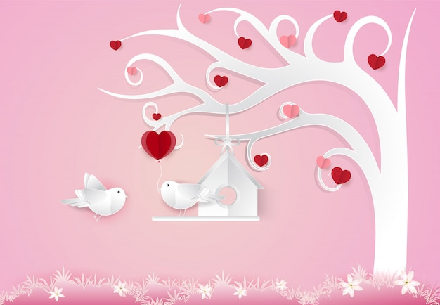 Uccelli delle coppie e concetto del biglietto di s. valentino dell'albero del cuore