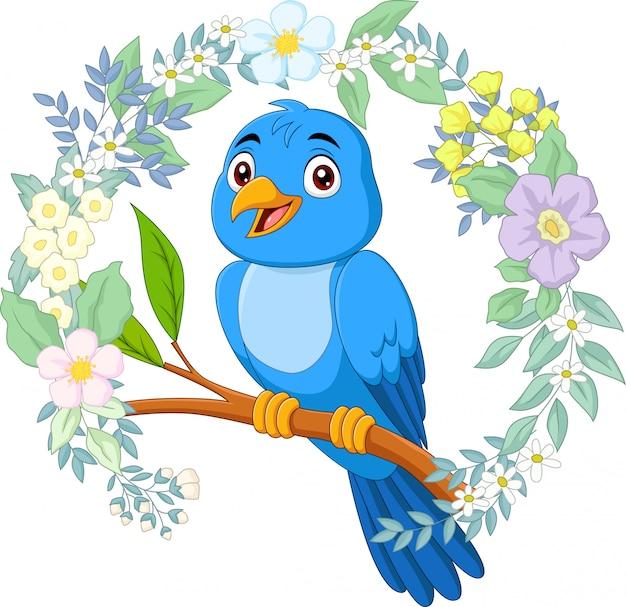 Uccello blu del fumetto sul ramo di albero con il fondo dei fiori