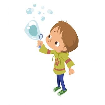 Un bambino che gioca con la bolla