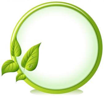 Un bordo rotondo con quattro foglie verdi