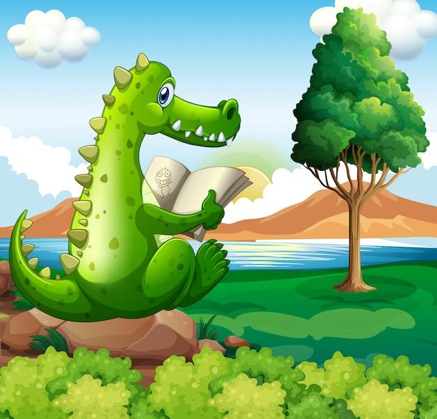 Un coccodrillo seduto sopra la roccia mentre legge vicino al fiume