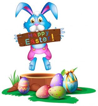 Un coniglio che tiene un saluto di pasqua, cartolina d'auguri