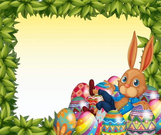 Un coniglio maschio in una cornice a foglia verde