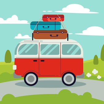 Un furgone rosso sulla strada. sopra il furgone rosso hanno molte borse per un buon viaggio.