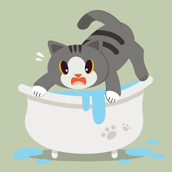 Un gatto sveglio del fumetto del carattere ha paura sulla vasca da bagno.