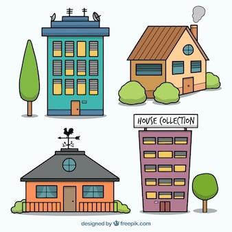 Un insieme di case disegnate a mano facciate con alberi e arbusti