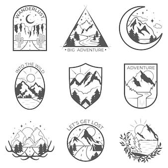 Un insieme di nove distintivi delle avventure della montagna e all'aperto di vettore.