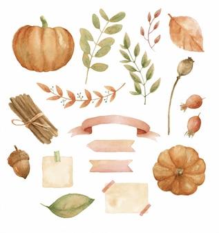 Un insieme di oggetti autunno / autunno che includono: zucche, foglie, nastri, rosa, cannella, ghianda