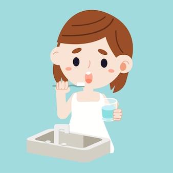 Un look da ragazza confonde con il lavandino. ragazza tenendo il bicchiere. bicchiere di wat