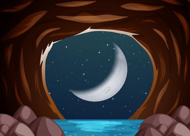 Un paesaggio di grotta di acqua di notte