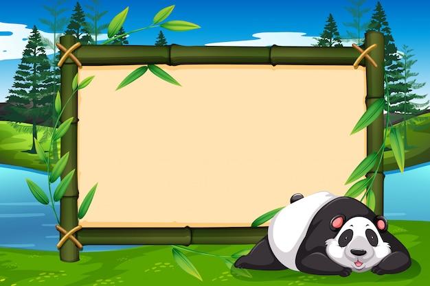 Un panda su una cornice di bambù