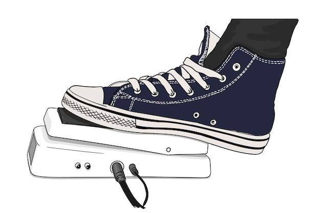 Un piede di chitarristi in una scarpa da tennis preme un pedale effetto chitarra, primo piano.