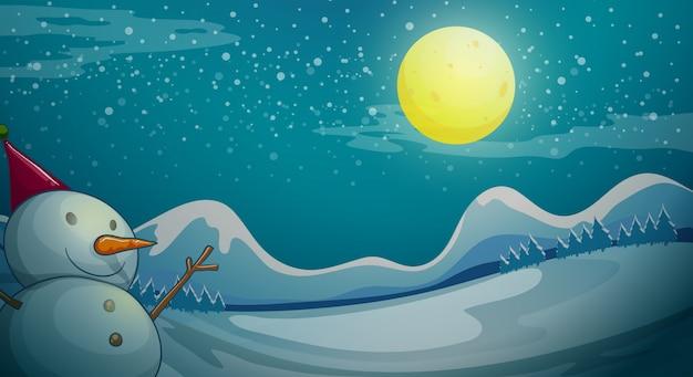 Un pupazzo di neve sotto la luna luminosa