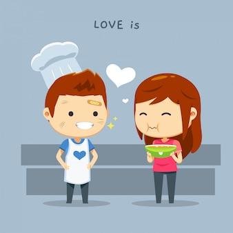 Un ragazzo che indossa cappello da cuoco e una ragazza con una ciotola di cibo