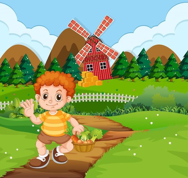 Un ragazzo con cesto di verdure in fattoria