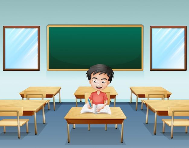 Un ragazzo dentro un'aula con un tabellone vuoto sul retro