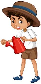Un ragazzo felice con annaffiatoio rosso