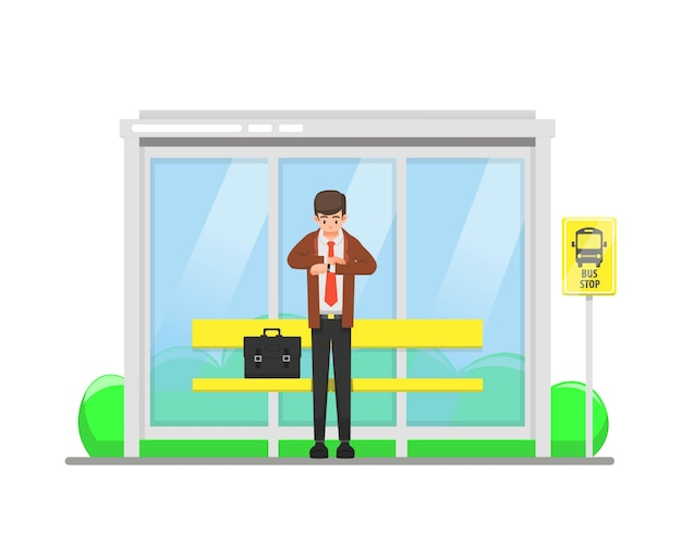 Un uomo aspetta alla fermata dell'autobus mentre guarda l'ora sul suo orologio