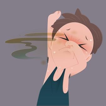 Un uomo che sente l'odore del suo cattivo odore sotto l'ascella e l'odore del corpo.