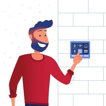 Un uomo che utilizza il pannello di controllo della casa intelligente.