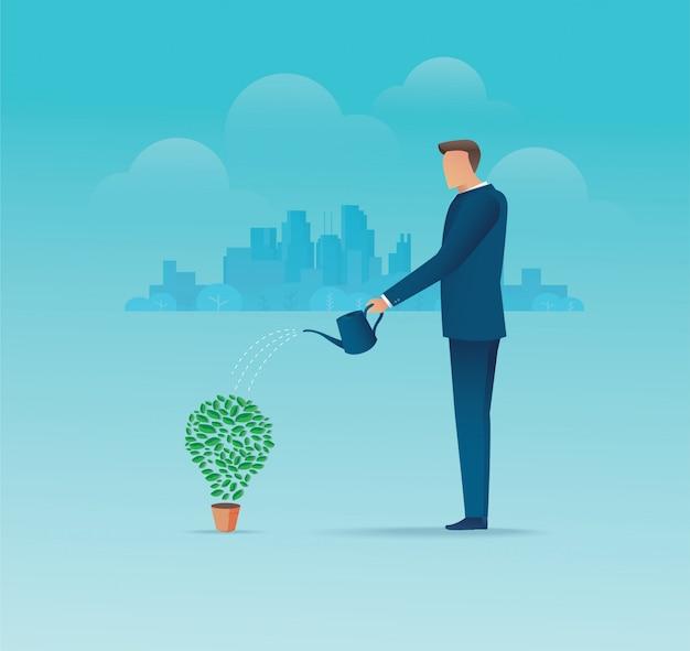 Un uomo d'affari che innaffia la pianta di forma della lampadina