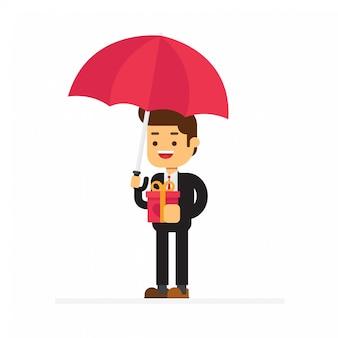 Un uomo d'affari in piedi tenendo l'ombrello