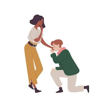 Un uomo innamorato bacia la mano della ragazza e le chiede di sposarlo