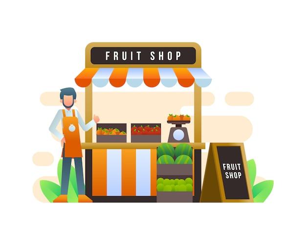 Un venditore si trova di fronte a un negozio di alimentari