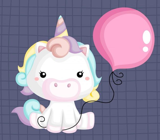 Un vettore di un unicorno carino che tiene un pallone