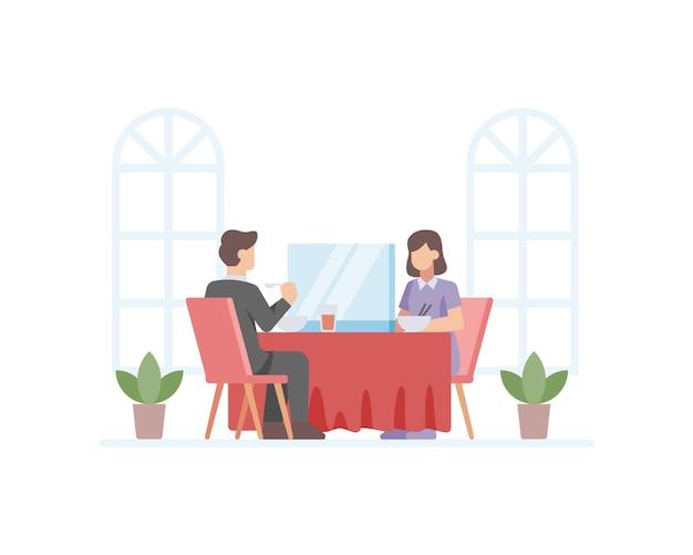 Una coppia mangia in un ristorante separato da un bicchiere per prevenire l'illustrazione della trasmissione del virus coronavirus