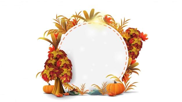 Una cornice rotonda di foglie autunnali ed elementi autunnali