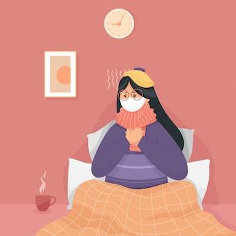Una donna con mal di gola, che indossava una maschera, fu confinata in casa per vedere i sintomi del virus covid-19.