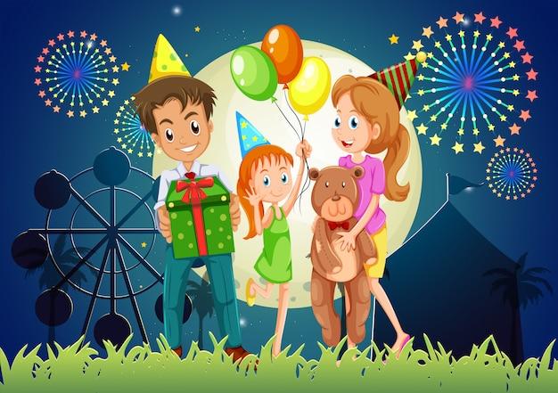 Una famiglia che celebra all'aperto vicino al carnevale