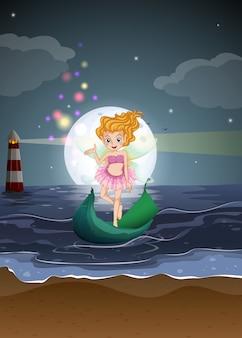 Una fata in piedi su una barca in spiaggia