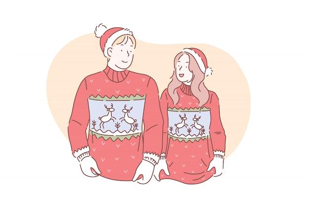 Una giovane coppia amorosa in maglioni di natale