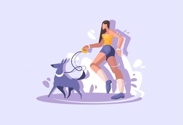 Una giovane ragazza cammina con un cane. passeggiare nel parco con animali domestici.
