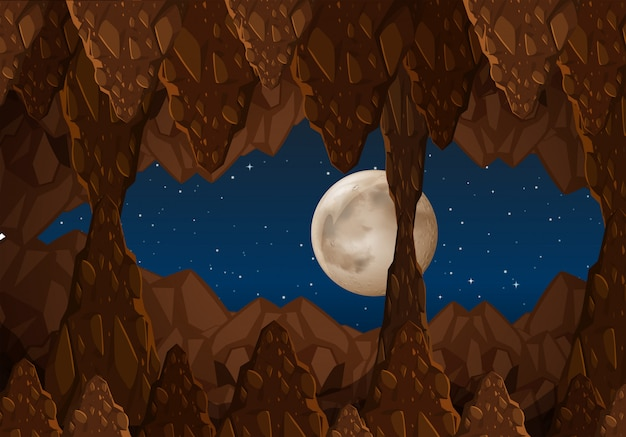Una grotta al paesaggio notturno