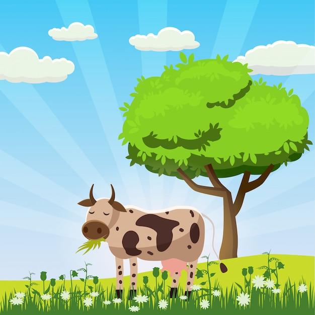 Una mucca pasce in un prato che mangia erba in un paesaggio