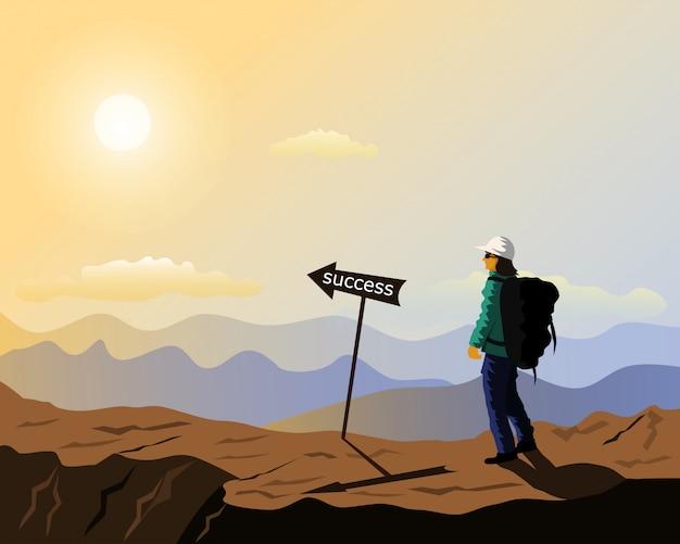 Una persona che cammina su una montagna con un segno di successo di fronte,