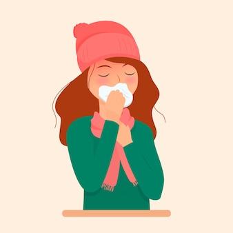 Una persona con un naso che soffia freddo