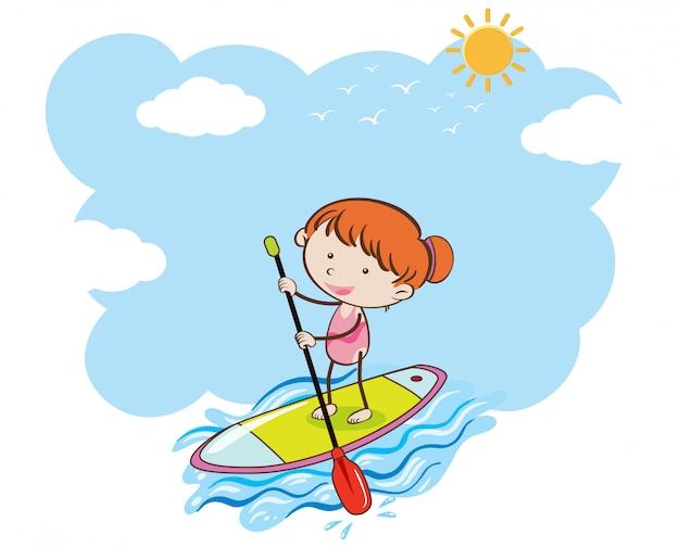 Una ragazza facendo stand up paddle board