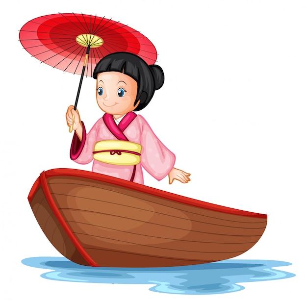 Una ragazza giapponese sulla barca di legno