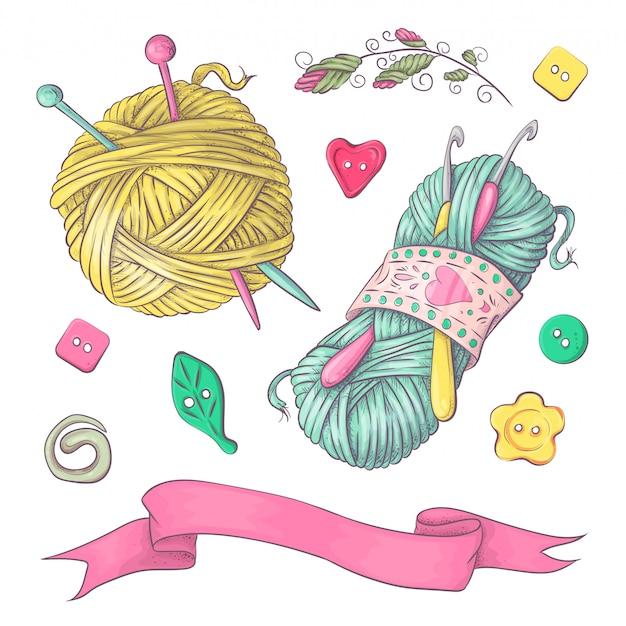 Una serie di vestiti lavorati a maglia gli aghi per maglieria.
