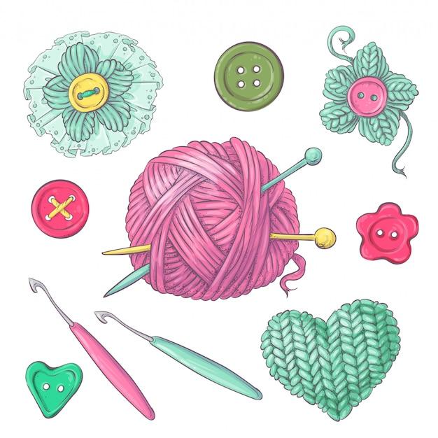 Una serie di vestiti lavorati a maglia gli aghi per maglieria
