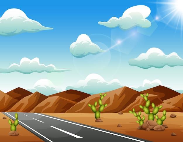 Una strada che porta alle montagne attraverso un deserto arido