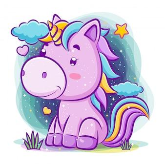Unicorno adorabile si siede sullo sfondo di notte