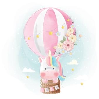 Unicorno arcobaleno volare con palloncino