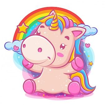 Unicorno carino adorabile si siede con sfondo arcobaleno