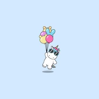 Unicorno carino con occhiali da sole in possesso di palloncini